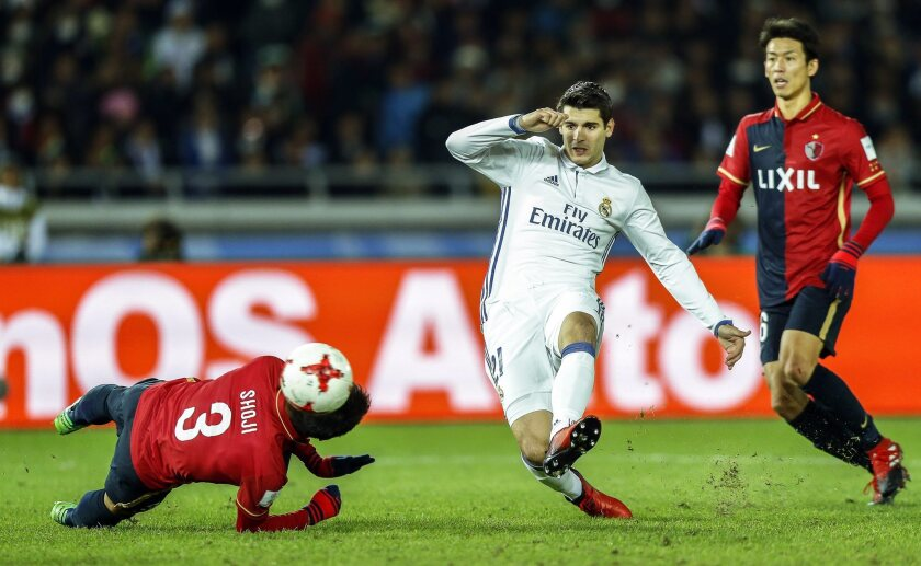 Real Madrid's Alvaro Morata (C) in action against Kashima Antlers' Gen Shoji (L) during the FIFA Club World Cup 2016 final between Real Madrid and Kashima Antlers in Yokohama, Japan, 18 December 2016. Real Madrid won 4-2 after extra time.