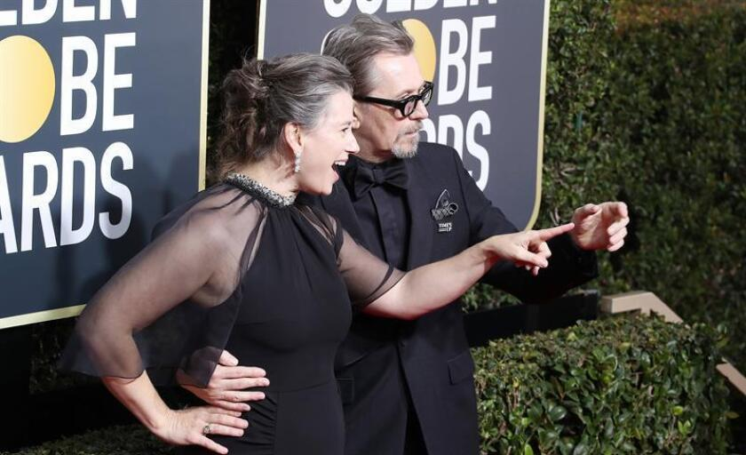 Gisele Schmidt (L) and Gary Oldman arrive for the 75th annual Golden Globe Awards ceremony at the Beverly Hilton Hotel in Beverly Hills, California. EFE