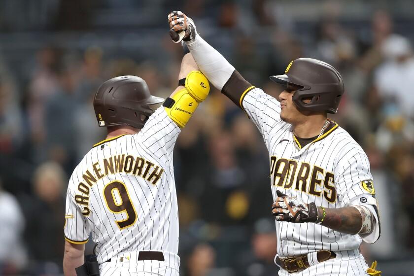 Jake Cronenworth congratulates Manny Machado after his two-run homer
