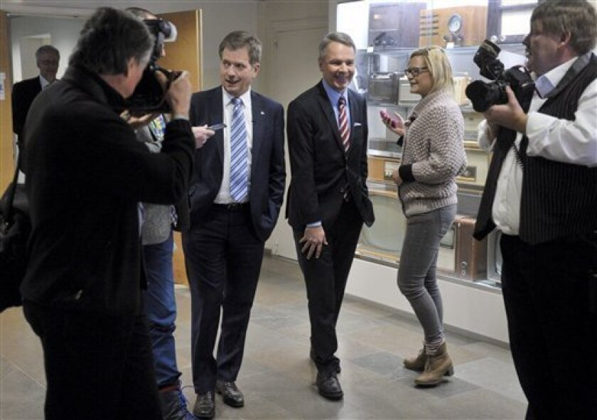 Finnish Presidential candidates Sauli Niinist, centre left, and Pekka Haavisto, centre right, arrive for a televised political debate at the Finnish broadcast company YLE in Helsinki, Finland, Thursday Feb. 2, 2012. Finns go to polls on upcoming Sunday, for the second decisive electoral round to vote one of these contenders into office, to succeed President Tarja Halonen. (AP Photo / LEHTIKUVA, Kimmo Mantyla) FINLAND OUT - NO SALES