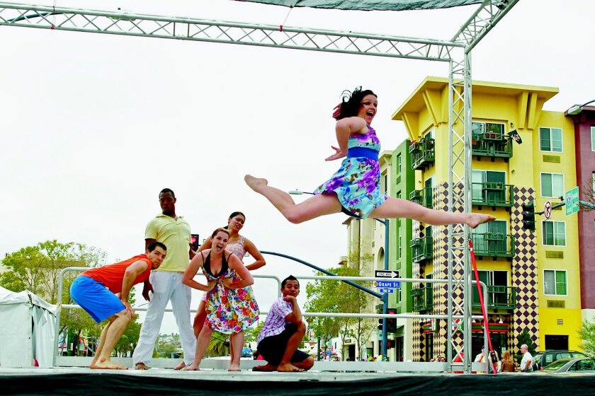 """Members of The PGK Dance Project perform Peter G. Kalivas' """"Stay"""" at the 2012 Dance on the Edge event at the Mission Federal ArtWalk in Little Italy. This year's festival is April 26-27. Sue Brenner"""