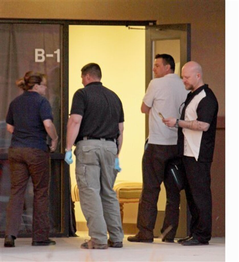 Investigators enter Bio Care Southwest in Albuquerque, N.M., on Wednesday, March 31, 2010. Police arrested Bio Care owner Paul Montano on three counts of fraud after investigators interviewed him on Wednesday. His business was linked through shipping labels to the discovery of six heads and numerou