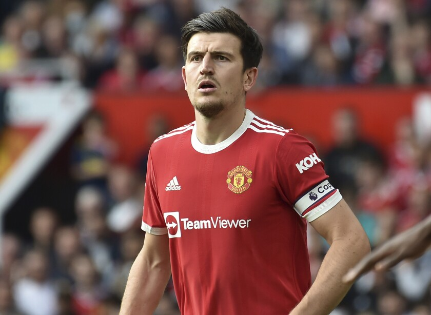 """FILE - In this Saturday, Sept. 11, 2021 file photo, Manchester United's Harry Maguire during the English Premier League soccer match between Manchester United and Newcastle United at Old Trafford in Manchester, England. Manchester United manager Ole Gunnar Solskjaer says captain Harry Maguire could be sidelined for """"a few weeks"""" with a calf injury. The center back was injured in a 1-0 loss to Aston Villa on Saturday and will miss United's match against Spanish team Villarreal in the Champions League group stage on Wednesday, Sept. 29, 2021. (AP Photo/Rui Vieira, File)"""