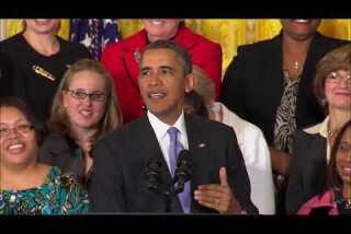 Obama signs equal-pay order
