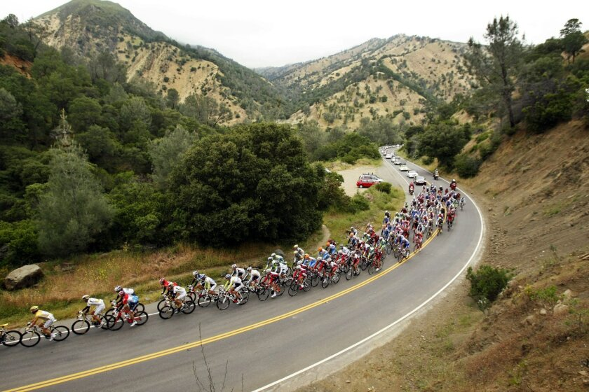 FILE - In this May 17, 2010 file photo, the peloton rides on a mountain road during the second stage of the Tour of California cycling race near Berryessa Pines, Calif. California lawmakers and an array of interest groups are ramping up effort to designate four new national monuments in the state. From bill introductions to appearances at the sites by high-profile guests, they want to win protections before President Barack Obama leaves office.(AP Photo/Marcio Jose Sanchez, File)