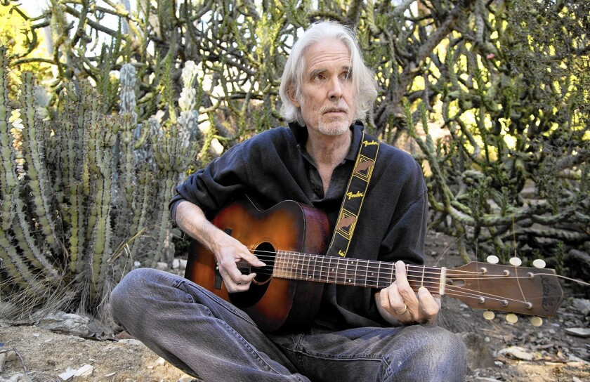 Guitarist Tony Gilkyson, formerly of X and Lone Justice, and who has played with the likes of Alice Cooper and Bob Dylan, sits near his home in Mt. Washington. He is scheduled to perform Thursday at Burbank's Viva Cantina.