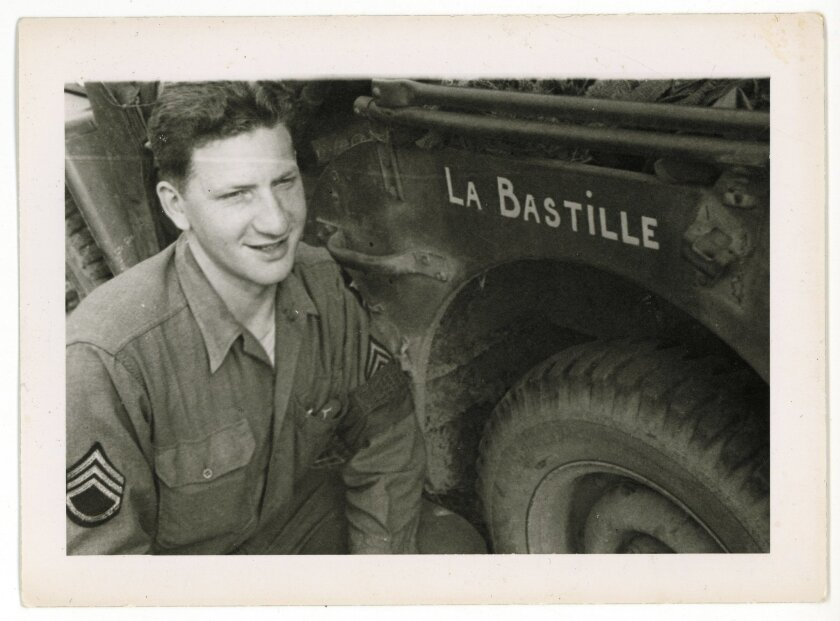 ADVANCE FOR STORY SLUGGED D-DAY FRENCH GI BY LORI HINNANT FOR RELEASE ON WEDNESDAY, MAY 28, 2014. In this photo dated July 1944 and provided by Dargols' family shows Bernard Dargols posing next to a  Willys MB U.S. Army Jeep in Normandy, France. When the young Frenchman left Paris at age 18, the pl