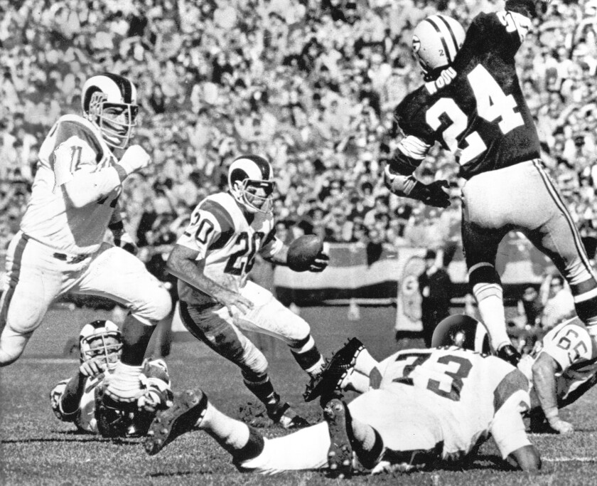 Running back Tommy Mason (20) pickes up yardage for the Los Angeles Rams in a 1970 game against the Green Pay Packers.