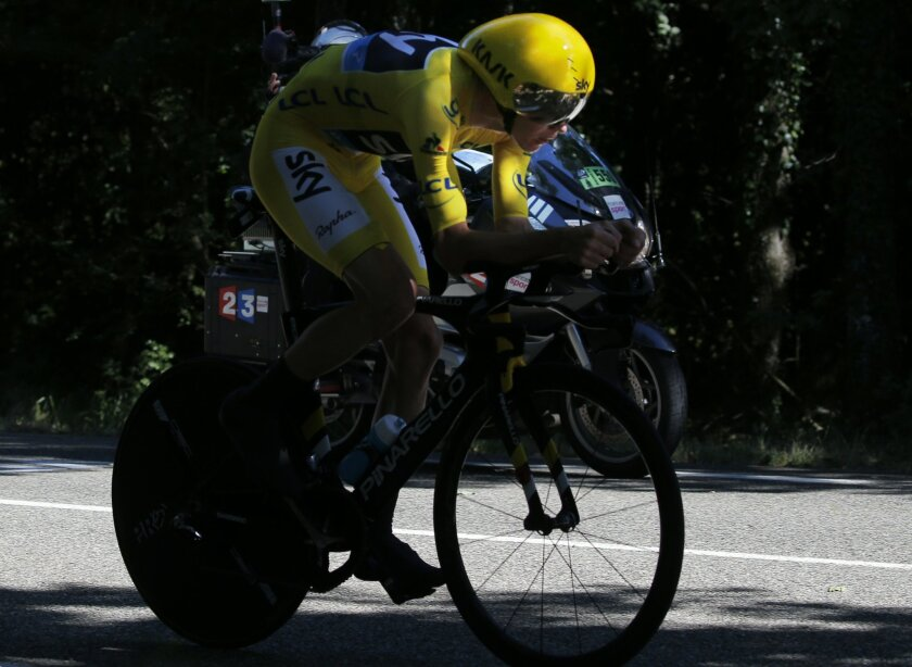 Britain's Chris Froome, wearing the overall leader's yellow jersey, rides during the thirteenth stage of the Tour de France cycling race, an individual time trial over 37.5 kilometers (23 miles) with start in Bourg-Saint-Andeol and finish in La Caverne du Pont-d'Arc, France, Friday, July 15, 2016.