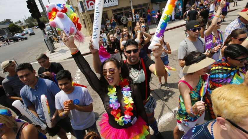 People gather every year to cheer on the participants of the San Diego Pride parade as it makes its way along University Avenue in Hillcrest.