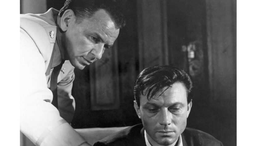 """Raymond, why don't you relax with a game of solitaire?"" Frank Sinatra tries to de-program brainwashed Army buddy Laurence Harvey in ""The Manchurian Candidate."""