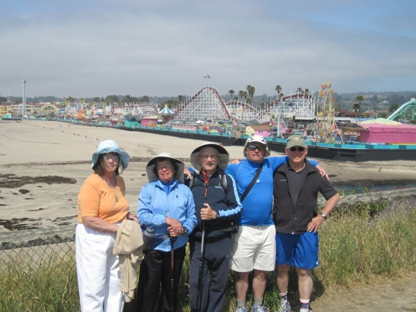 Members of the Coast Walkers include Nick and Ann Haritatos, Ron Williamson, Joanna Brown, and Leila and Marshal Taylor, pictured here looking at the Boardwalk at Santa Cruz, the midpoint in their walk from the San Diego/Tijuana border to California's northern border. Courtesy