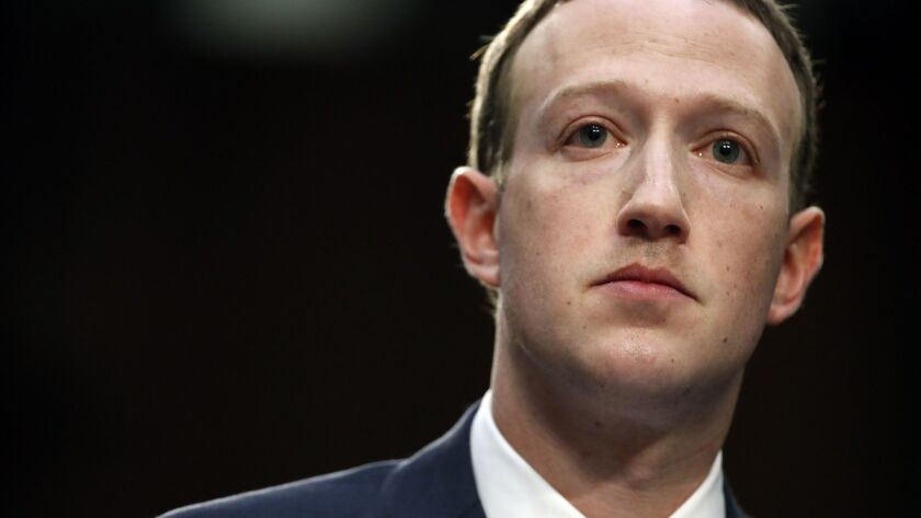 Facebook CEO Mark Zuckerberg testifies before a joint hearing of the Commerce and Judiciary committees in Washington on April 10.