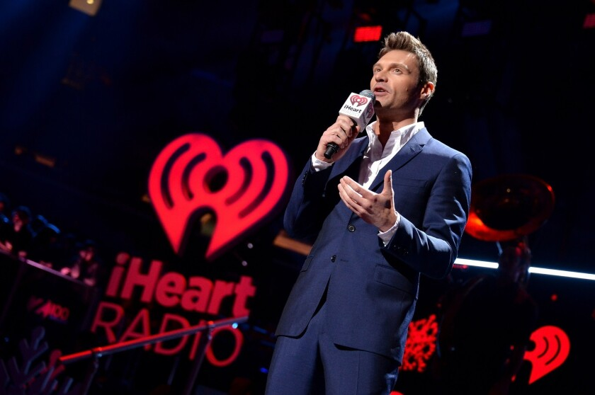 Radio and TV personality Ryan Seacrest speaks onstage at the final stop of the IHeartRadio Jingle Ball tour at Madison Square Garden in New York.