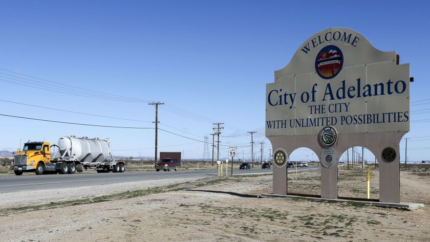 Sign along Highway 395 advertises a city with unlimited possibilities.