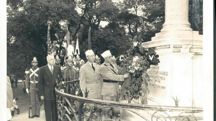 A Vintage photograph shows a wreath-laying ceremony at a monument erected in Brooklyn for the Maryla
