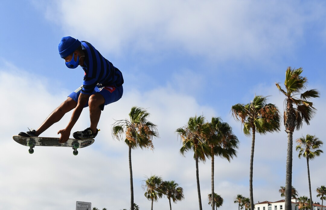 Isiah Hilt gets air while doing tricks in Venice Beach on Tuesday.