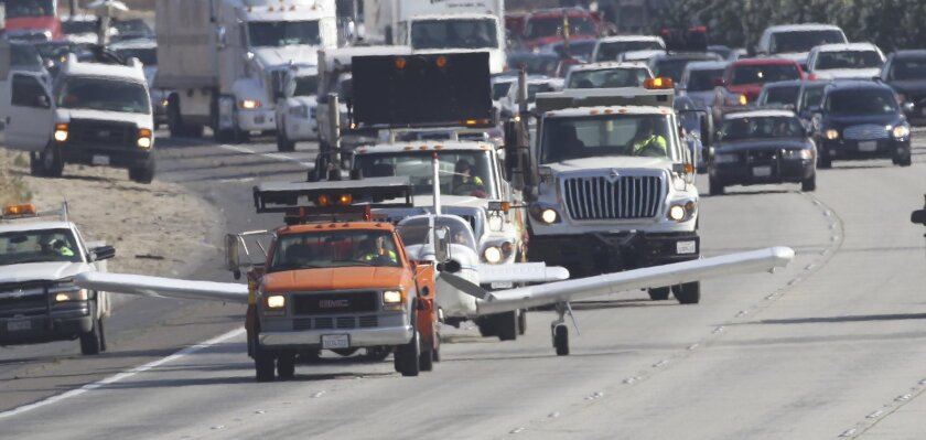 A CalTrans employee steered and braked a disabled plane off of I-15 in the southbound lanes after the plane ran out of fuel and the pilot and three other people landed unhurt.