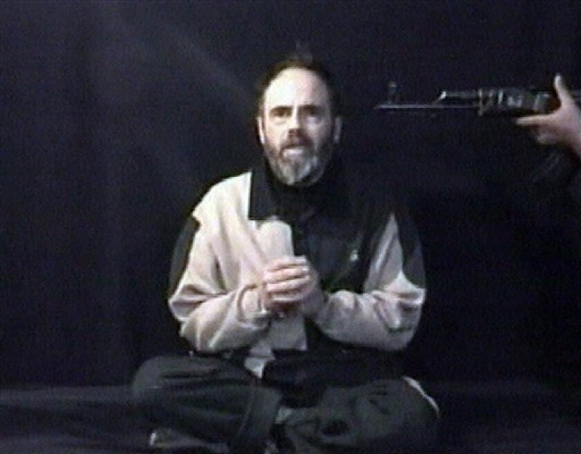 FILE - In this file photo taken from insurgents video released on Tuesday Jan. 25, 2005, a man who identifies himself as American Roy Hallums pleads for Arab rulers to intercede to spare his life. Hallums was kidnapped by gunmen in Iraq in 2004 and held for 311 days before U.S. Army Delta Force operators rescued him from a small, underground room. U.S. special forces units are compiling a string of successful hostage rescues, thanks to improved technology and a decade of wartime experience. But despite technological advances like thermal imaging and surveillance drones, the raids remain high-risk. (AP Photo/Insurgents video via APTN, File) TV OUT