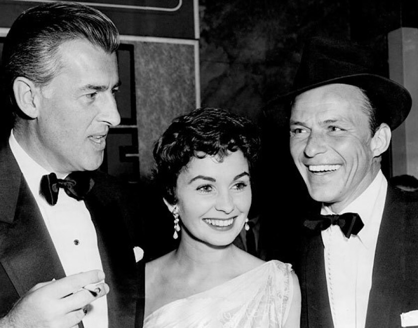 """Jean Simmons, center, with her husband, Stewart Granger, left, and Frank Sinatra at the premiere of """"Guys and Dolls"""" in 1955."""