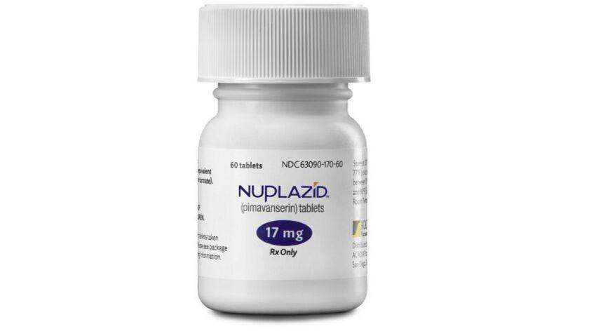 NUPL16CDLA0972 - product shoot of Nuplazid boxes, bottles, tablets, shelf talker, and hand models wi