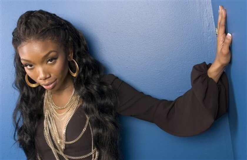 Singer Brandy is photographed in New York on Monday, Nov. 3, 2008. (AP Photo/Jim Cooper)