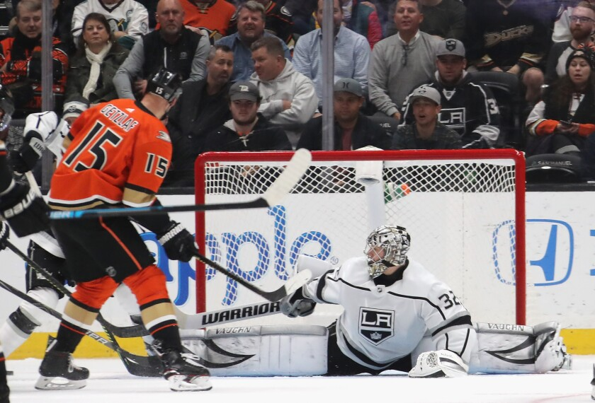 Kings goalie Jonathan Quick (32) defends the net against Ducks' Ryan Getzlaf (15) during the second period at the Honda Center on Thursday.