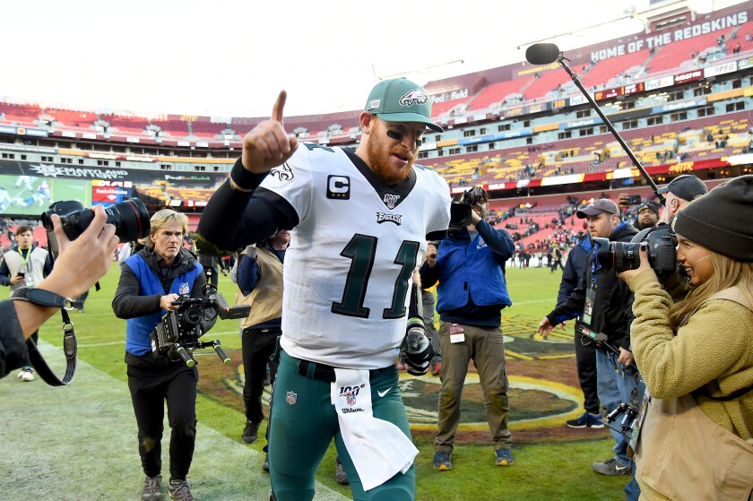 Philadelphia quarterback Carson Wentz celebrates the Eagles' win over the Washington Redskins on Sunday.