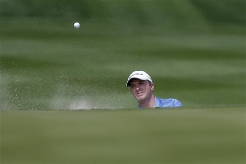 Martin Laird, of Scotland, hits out of the sand on the 13th hole during the final round of the Texas Open golf tournament on Sunday, April 7, 2013, in San Antonio. Laird won the tournament. (AP Photo/Eric Gay)