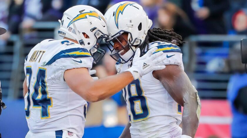 Chargers running back Melvin Gordon reacts with fullback Derek Watt after Gordon scored a touchdown against the Baltimore Ravens during the second half of the AFC wild-card playoff game on Jan. 6.