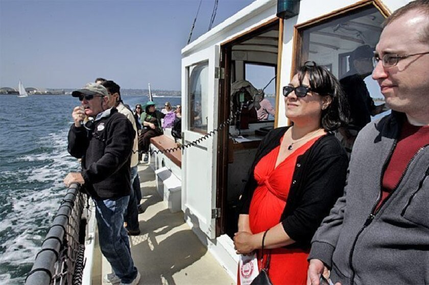 Mark Gallant narrated a boat tour of San Diego Bay for Angie Folz and Thomas Hazl, both from Dallas, and other passengers aboard the Pilot yesterday. (Laura Embry / Union-Tribune)
