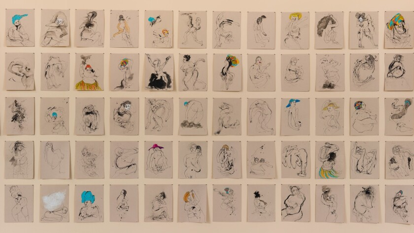 Kenyatta A.C. Hinkle's ink drawings of 100 missing African American women are simply push-pinned to the wall.