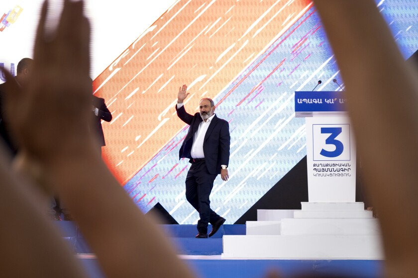 FILE In this file photo taken on Thursday, June 17, 2021, Armenian Prime Minister Nikol Pashinyan greets his supporters during a rally in his support prior to upcoming parliamentary elections in the center Yerevan, Armenia. Armenian voters will go to the polls for early parliamentary elections on Sunday, June 20, 2021. Armenians head to polls Sunday for an early parliamentary election stemming from a political crisis that has engulfed the country in the aftermath of the last year's fighting with Azerbaijan over the separatist region of Nagorno-Karabakh. (AP Photo/Areg Balayan, File)