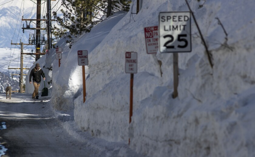 MAMMOTH LAKES, CALIF. -- WEDNESDAY, MARCH 13, 2019: Snow is piled nearly 20 feet high along Davison