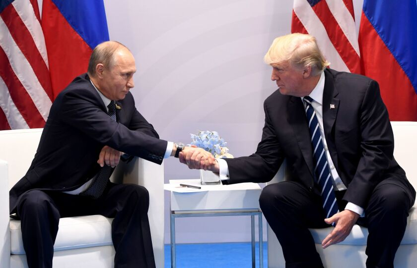 President Donald Trump and Russia's President Vladimir Putin shake hands during a meeting on the sidelines of the G20 Summit in Hamburg, Germany, on July 7, 2017.