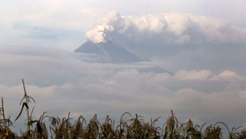 View of the Popocatepetl volcano emitting a column of steam and gas, from San Andres Calpan, Mexico, Sept. 27, 2017.