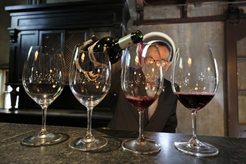 Wine educator David Mayer pours zinfandel