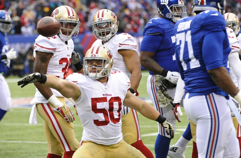 San Francisco linebacker Chris Borland celebrates after intercepting a pass during the first half of a game Nov. 16 against the New York Giants. Borland announced his retirement from the NFL on Monday.