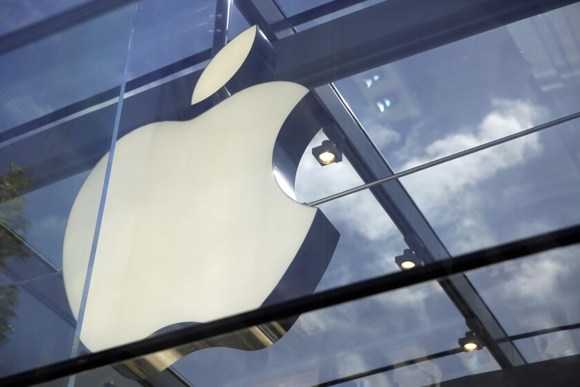 The Apple logo is seen on an Apple Store in Palo Alto, Calif.