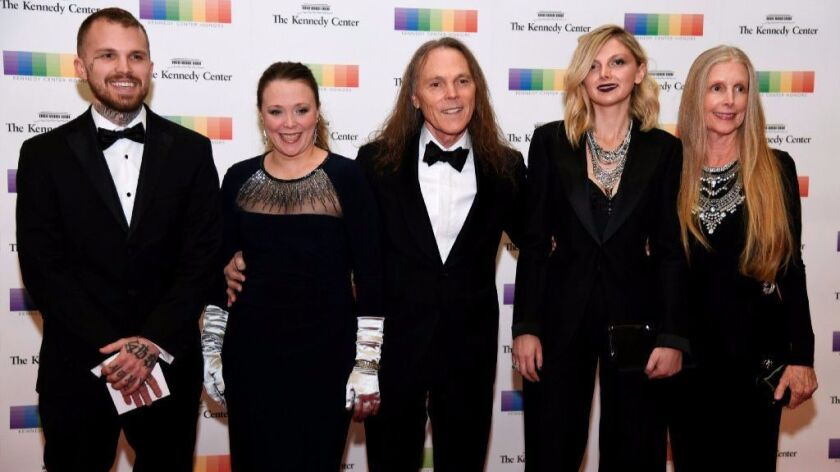 Kennedy Center Honors recipient TimothyB.Schmit of the Eagles (center) poses with his wife Jean (right), daughter Owen (second from right), son Ben (left) and daughter Jeddrah (second from left).