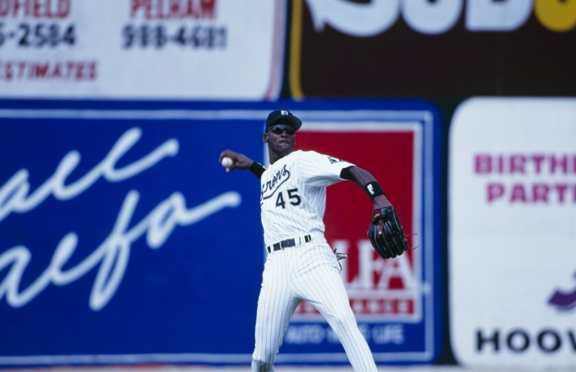 Michael Jordan of the Birmingham Barons throws during an August 1994 game against the Memphis Chicks in Hoover, Ala.