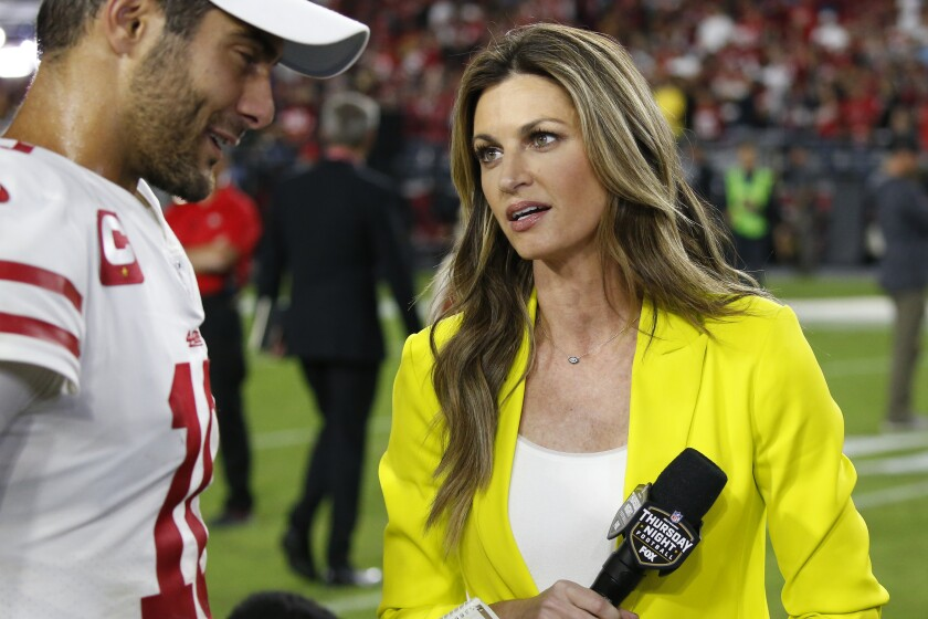 Fox sideline reporter Erin Andrews speaks with San Francisco 49ers quarterback Jimmy Garoppolo after a game against the Arizona Cardinals on Oct. 31 in Glendale, Ariz.