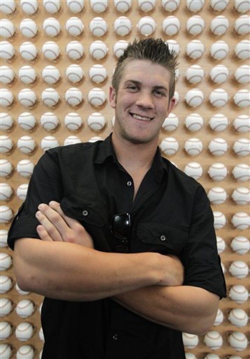 Baseball player Bryce Harper poses for photos in Newport Beach, Calif., Monday, June 7, 2010. The Washington Nationals selected Harper with the No. 1 overall pick in the baseball draft Monday night. (AP Photo/Jae C. Hong)