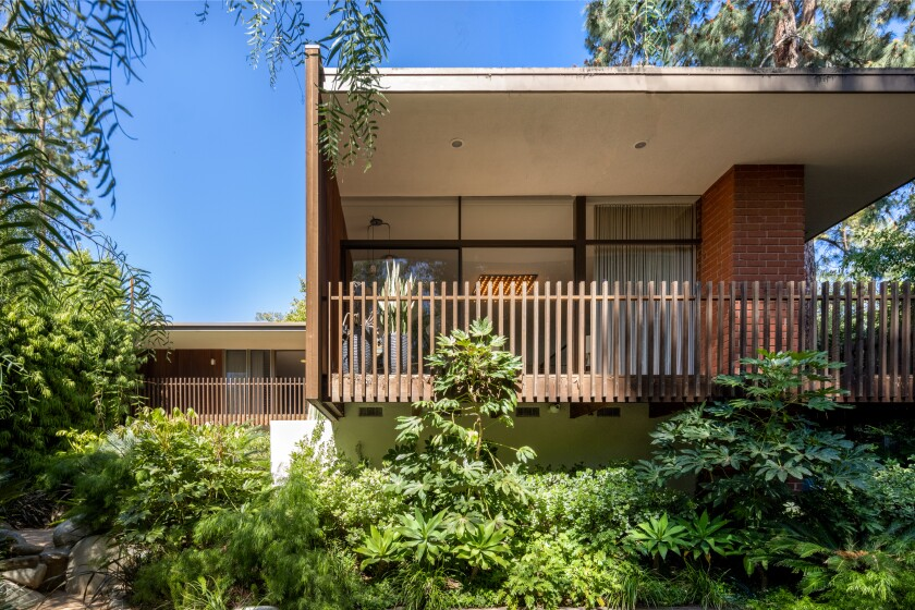 Built in 1961, the single-story home features Midcentury charms such as a courtyard entry, sky-lit hallways and warm wood-and-glass living spaces.