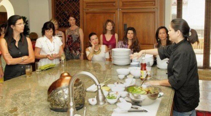 Guest chef Napasiri Kay Eksupapan leads a Thai cooking class. Photo: Jon Clark