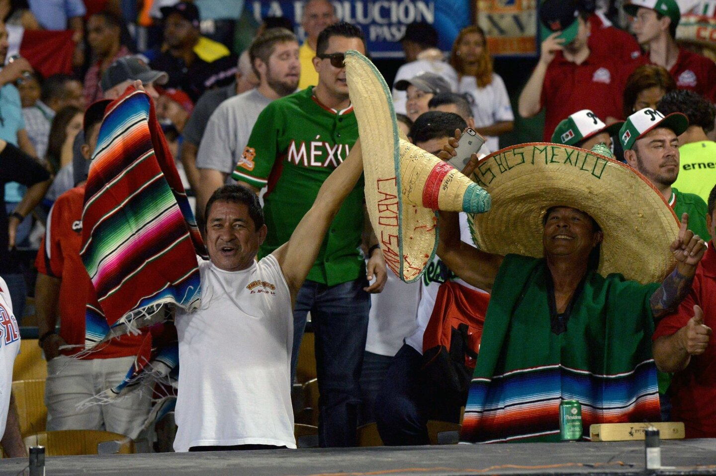 Supporters of Mexico cheer for their team during their 2016 Caribbean baseball series game against Venezuela on February 3, 2016 in Santo Domingo. AFP PHOTO/YAMIL LAGEYAMIL LAGE/AFP/Getty Images ** OUTS - ELSENT, FPG, CM - OUTS * NM, PH, VA if sourced by CT, LA or MoD **