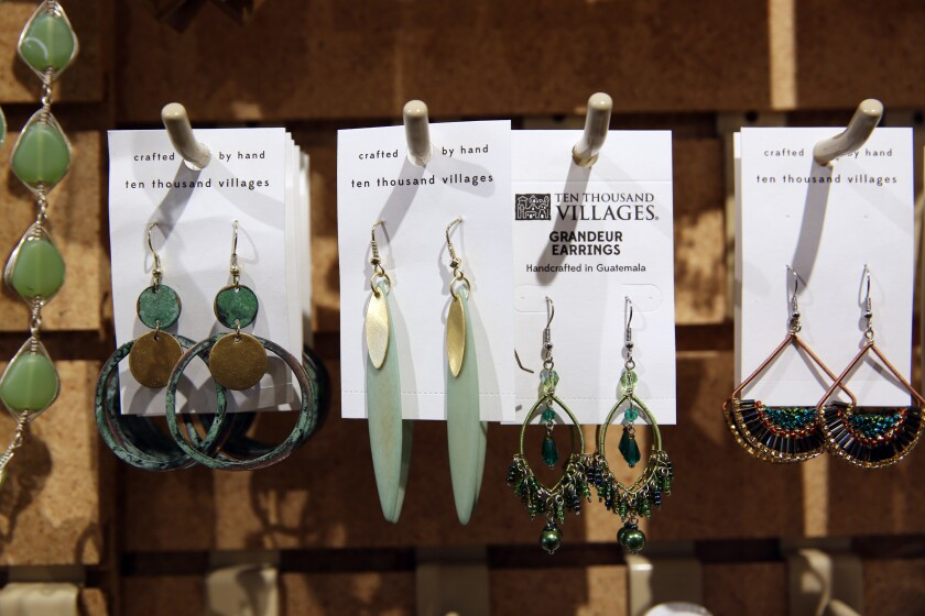 Earrings are on display at Ten Thousand Villages, a nonprofit fair trade organization that markets handcrafted products made by disadvantaged artisans from more than 35 countries.