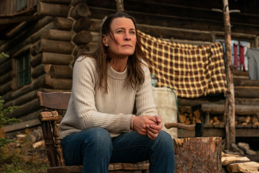 """Robin Wright sits on her porch in """"Land."""""""