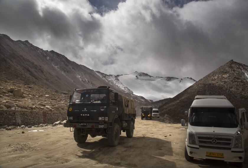 An Indian army truck drives near Pangong Lake in India's Ladakh border region in 2018.