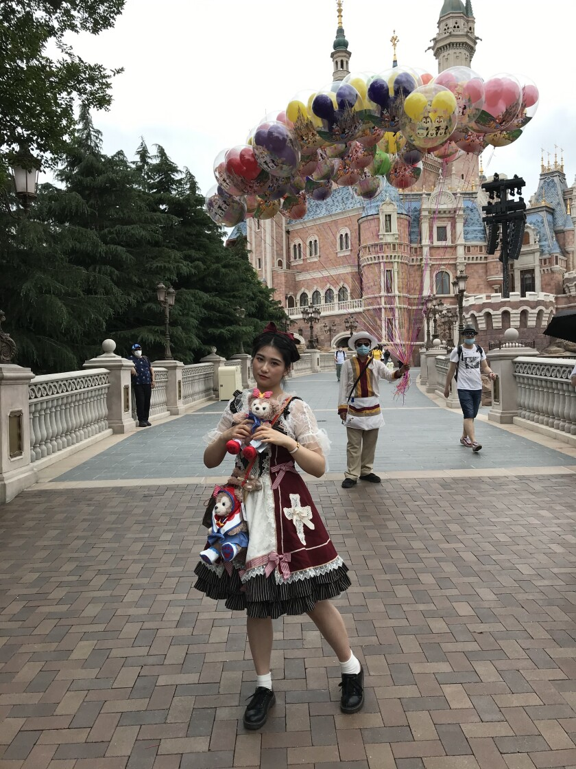 Fan Shuqian, 24, said she bought this dress from Japan to wear for photos in Disneyland.